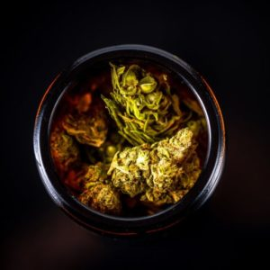 Cannabis Flower Buds in Glass Jar preparation for selling in Cannabis Shop